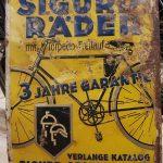 Lot 97: Blechschild SIGURD, 51 x 36 cm, selten, leider stark patiniert - Ausrufpreis: 1,00€